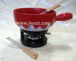 Insieme di ceramica della fonduta di cioccolato