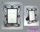 Photo frame with twisted design